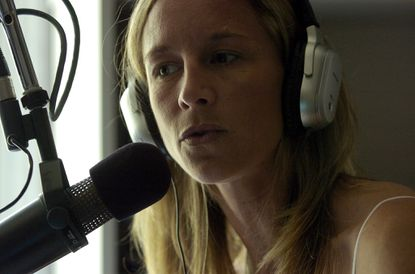 Anita Marks at the microphone for 105.7 The Fan in her Baltimore days.