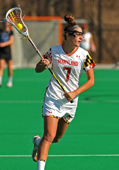 Katie Schwarzmann carries the ball for Maryland against Duke during her college playing days with the Terps.