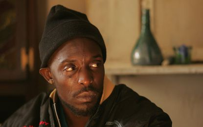 """**FILE**This undated photo, supplied by HBO, shows Michael K. Williams, who plays Omar Little, Baltimore's most-feared stickup artist, on the HBO cable television series, """"The Wire."""" Stickup man Omar Little, the most beloved character on the HBO series """"The Wire,"""" was dispatched in shocking fashion Sunday night, taking a bullet to the back of the head as he bought a pack of Newports at a convenience store. His killer: Kenard, a boy no older than 12 and a minor player in the drug gang Omar was targeting. (AP Photo/HBO, Paul Schiraldi, File)"""