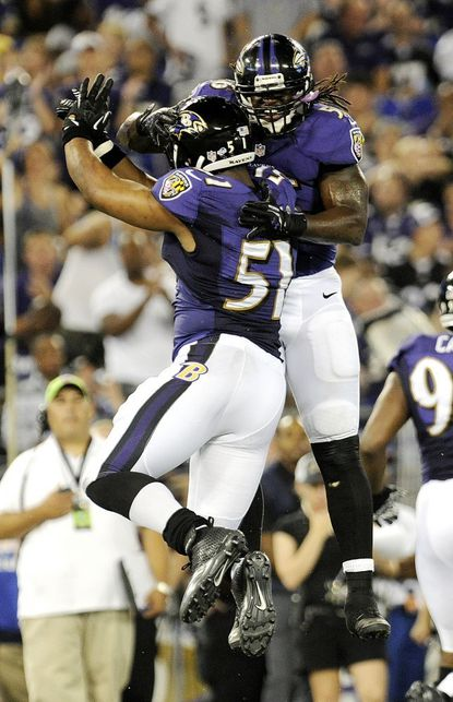 Daryl Smith, left, celebrates with Josh Bynes after sacking Panthers quarterback Cam Newton during the Baltimore Ravens' preseason game against the Carolina Panthers at M&T Bank Stadium in Baltimore Thursday.