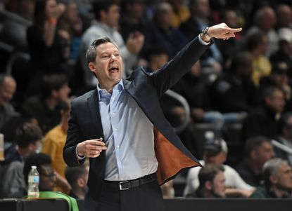 UMBC head coach Ryan Odom directs his players against Harford in the second overtime of this year's America East men's basketball semifinal.