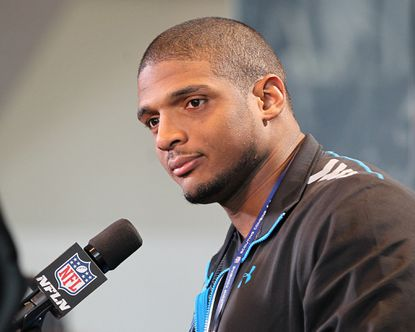 Missouri Tigers defensive end Michael Sam speaks at the NFL scouting combine at Lucas Oil Stadium.