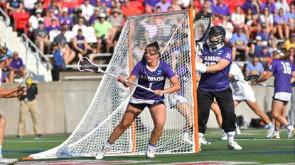 Laurel resident Emma Johnson, shown in James Madison University's 15-12 win over North Carolina in the national lacrosse semifinals, had 34 caused turnovers for the Dukes, who won the national title with a 16-15 victory over Boston College.