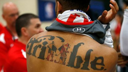 "Maryland's Melo Trimble reverses his jersey and exposes a tattoo of his last name with a Maryland themed ""M"" as he participates at the NBA draft basketball combine Thursday, May 11, 2017, in Chicago."