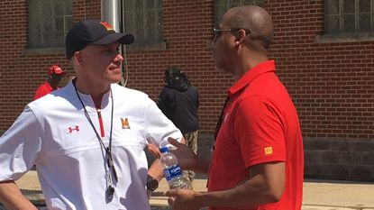 Maryland acting athletic director Damon Evans, right, talks with football coach DJ Durkin after Saturday's Red-White spring game.