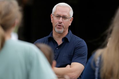 Todd Pletcher the trainer of Always Dreaming, Patch and Tapwirit talks in the barn area during the morning training for the Kentucky Derby at Churchill Downs on April 30, 2017 in Louisville, Kentucky.