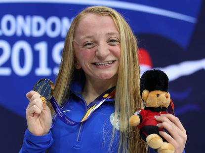 McKenzie Coan of the USA poses with her gold medal after winning the Women's 100m freestyle S7 final during the London 2019 World Para-swimming Allianz Championships on September 14, 2019.