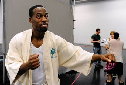 "Morgan State alumnus Soloman Howard, who plays Muhammad Ali, rehearses for the new opera ""Approaching Ali."" The music was composed by D.J. Sparr, a graduate of the Baltimore School for the Arts who was raised in Carroll County."
