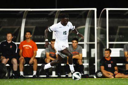 Loyola men's soccer player Josh Fawole controls the ball against Princeton.