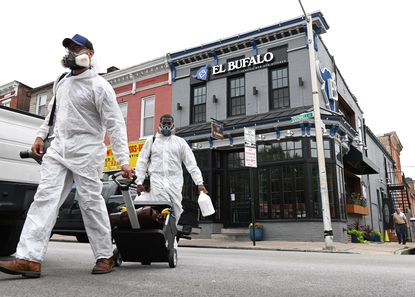 Workers from the company Disinfect-It head to Cowboy Row in Canton as several restaurants have temporarily closed because of the recent outbreak of restaurant employees in the area testing positive for COVID-19. El Bufalo Tequila Bar and Kitchen is one of the restaurants that has recently closed.