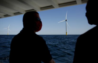 Officials with Old Dominion University, Dominion Energy, the Virginia Aquarium and others visit the pilot site for the Coastal Virginia Offshore Wind Project hours off the coast of Virginia Beach, Va., on Thursday, Oct. 8, 2020. (Stephen M. Katz/The Virginian-Pilot via AP)