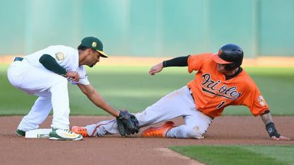 Orioles shortstop Manny Machado is tagged out Athletics shortstop Marcus Semien while attempting to steal second base in the top of the fourth inning Saturday at Oakland Coliseum.