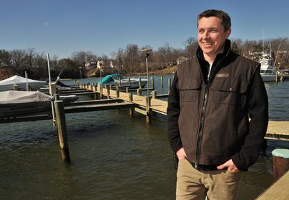 Boyd Tomkies walks along The Marina on the South River, which he is building on the former Marks Marina. He plans to open by April. Tomkies, a native of New Zealand, will be speaking at the Marine and Maritime Career Fair at Annapolis High Sschool on Feb. 25.
