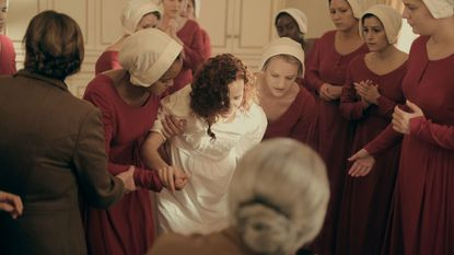 Offred (Elisabeth Moss) and her fellow Handmaids assist with the delivery of Janine's (Madeline Brewer) baby.
