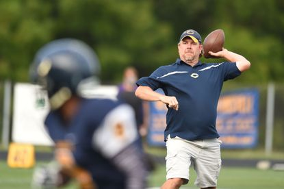 As head football coach Rich Hambor showed off his throwing before a scrimmage. Hambor, currently the Catonsville athletic director, was recognized by the National Interscholastic Athletic Administrators Association as a certified athletic administrator.