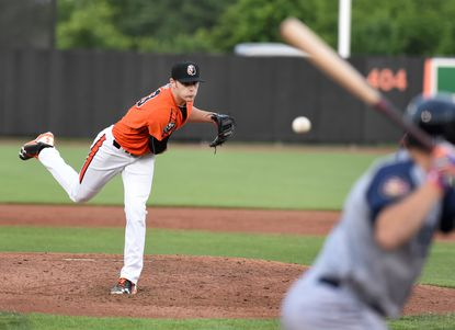 Aberdeen pitcher Brenan Hanifee delivers the pitch to the waiting Brooklyn batter in the early innings of Wednesday night's game at Leidos Field at Ripken Stadium.