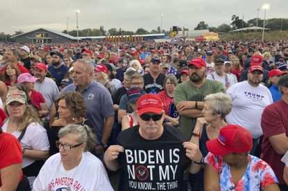 People gather ahead of an appearance by former President Donald Trump at a rally at the Iowa State Fairgrounds in Des Moines, Iowa., Saturday, Oct. 9, 2021. (AP Photo/Thomas Beaumont)
