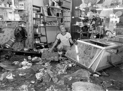 Eileen Aaron, owner of the Something Special boutique, begins cleaning out her Newbury Street store. Waist-high water destroyed most of her stock. Tropical Storm David's flooding caught Mount Washington merchants by surprise.