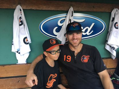 Orioles first baseman Chris Davis welcomed Henry Frasca to Fenway Park on Saturday. Frasca wrote Davis a letter in April encouraging him during his record hitless streak. (Nathan Ruiz/The Baltimore Sun)