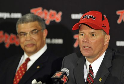 University of Maryland director of athletics, Kevin Anderson (left), introduces the football teams' new coach, Randy Edsall, as Ralph Friedgen's replacement