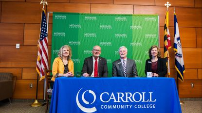 From left, McDaniel College Provost Julia Jasken, McDaniel President Roger Casey Carroll Community College President James D. Ball, and Vice President of Academic & Student Affairs at Carroll Rosalie Mince sign a transfer agreement for students seeking education degrees.