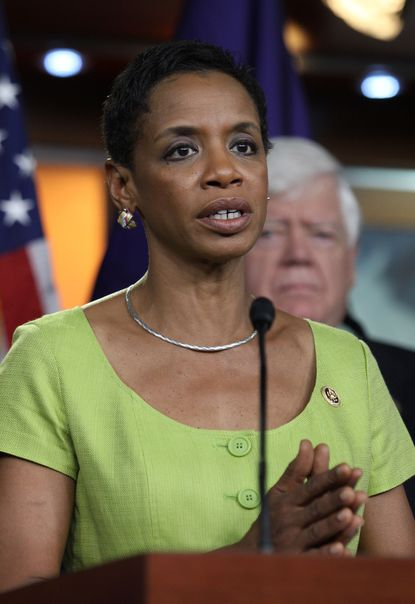 Rep. Donna Edwards, D-Md., accompanied by fellow House Democrats, speaks during a news conference on Capitol Hill in Washington, Tuesday, June 16, 2016, to discuss opposition to the President Barack Obama's trade deal. Despite Obama's direct appeal, House Democrats voted overwhelmingly on Friday to reject a jobs retraining program because it was legislatively linked to fast track, which they want to kill. Both parties were asking Tuesday whether they could persuade enough colleagues to switch their votes and reverse Friday's outcome, but few were optimistic. (AP Photo/Lauren Victoria Burke) ORG XMIT: DCLB117