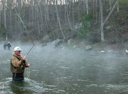 Retired Department of Natural Resources biologist and shad expert Dale Weinrich plays a hickory shad on fly tackle in Deer Creek.