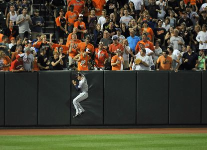 Twins left fielder Jordan Schafer cannot grab Delmon Young's home run in the fifth inning. The play was later reviewed and upheld.