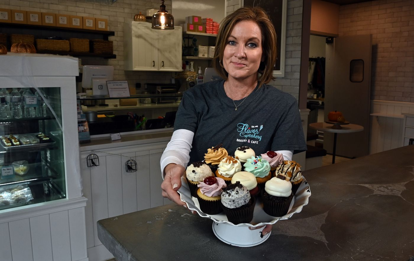 Shelley Standard, owner of Flavor Cupcakery Bakery and Cafe, with a sampling of boutique cupcakes.