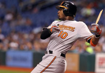 Adam Jones has his bat sawed in half during the second inning of Wednesday night's loss to the Tampa Bay Rays to close the regular season.