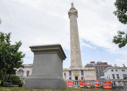 The Washington Monument and the now-empty plinth that used to hold a statue of Roger Taney in Baltimore's Mount Vernon neighborhood. 06-25-20