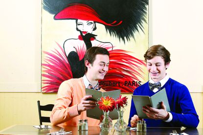 Charles Regnante, left, and his brother Thomas check out the menu at Leelynn's Dining Room & Lounge in Ellicott City. The brothers write a blog called 2 Dudes Who Love Food.