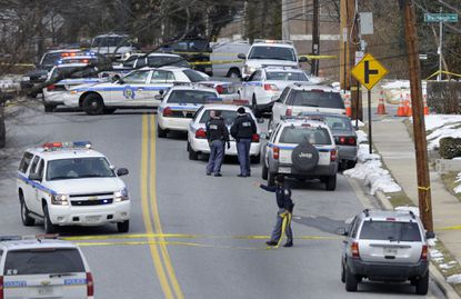 Baltimore County police work on Oakleigh Road in Parkville after a police-involved shooting.