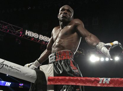 WBO welterweight champion Timothy Bradley Jr.celebrates on the ropes after knocking out Brandon Rios.