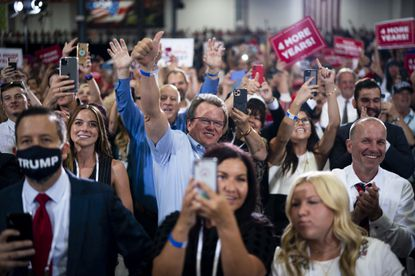 Attendees, most without face masks, during a campaign rally for President Donald Trump in Henderson, Nev., Sunday, Sept. 13, 2020. Thousands of Trump supporters, the vast majority of them forgoing face masks, packed inside a manufacturing plant on Sunday night in a Las Vegas suburb, where President Trump brashly ignored a state directive limiting indoor gatherings to under 50 people.