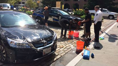 "Baltimore Police Commissioner Kevin Davis stopped by City Hall on Friday to have his car washed at the ""Squeegee Corps"" car wash. Mayor Catherine Pugh set up the service in June to employ what she calls the ""Squeegee boys,"" or youth who clean car windows on the street."