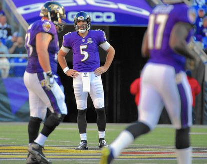 Baltimore Ravens quarterback Joe Flacco (5) stands in disbelief after throwing a second crucial interception to the Jacksonville Jaguars during the third quarter in Baltimore. The Ravens failed to finish, losing to the Jags, 22-20.