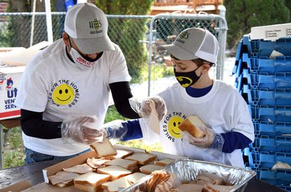 Jayden Steiner Friedman, 7 1/2 years old, right, had the idea to make 2020 sandwiches to distribute to needy people this Thanksgiving. Here, he makes the sandwiches with the help of his dad, Ben Friedman, left, in the family's backyard. The sandwiches will be distributed on Thanksgiving at Manna House in Baltimore. November 25, 2020