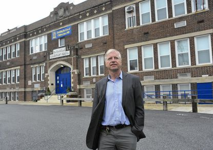 Catonsville resident Klaus Philipsen, a Baltimore City architect, is shown in front of Catonsville Elementary School. Philipsen is president of NeighborSpace of Baltimore County, a nonprofit that seeks to preserve open space in Baltimore County.
