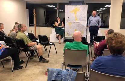 "Arts consultant Elizabeth Gallauresi, center left, and William ""Chris"" McCollum, center right, director of anchor initiatives for Baltimore County, take public comment during Baltimore County Arts Guild's community meeting at its Arbutus office Sept. 26 on the county's arts and entertainment district application, submitted to the Maryland State Arts Council Oct. 1."
