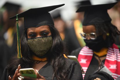 Tolu Akinsanya wears a glittery mask as she prepares for the commencement ceremony for the Class of 2021 at McDaniel College on Saturday, May 22, 2021. (Brian Krista/Baltimore Sun Media).