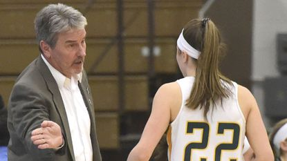 McDaniel College women's basketball interim coach Rick Little gives instructions to Jayce Klingenberg during a recent game at Gill Center in Westminster.
