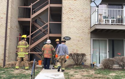 Firefighters go back to check at the scene of an apartment unit fire in Bel Air on Monday afternoon. A cat was rescued.
