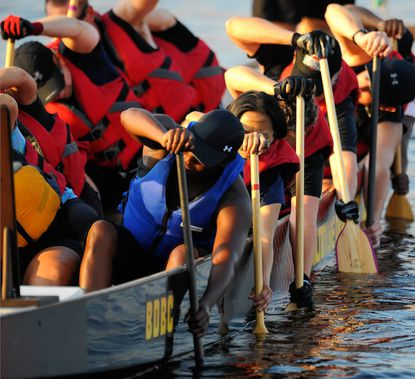The Baltimore Dragon Boat Club shown in practice in the harbor by the Under Armour Complex.