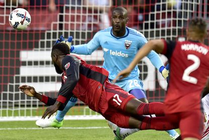 D.C. United goalkeeper Bill Hamid (28) keeps his eyes on the ball as Toronto FC forward Jozy Altidore (17) makes a diving header during the first halfin Toronto on Saturday, June 17, 2017.
