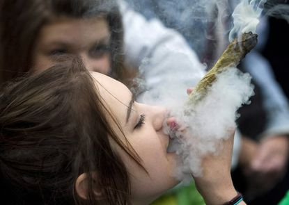 A woman smokes a marijuana joint in Vancouver.