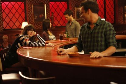 """During a flashback, Jess (Zooey Deschanel, L) contemplates her relationship with Nick (Jake Johnson, R) on """"New Girl."""""""