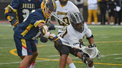 Towson defenseman Chad Patterson, defending a Drexel attack during the 2017 CAA tournament, is one of four returning Tigers starters.