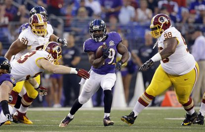 Baltimore Ravens running back Justin Forsett, center, rushes the ball in the first half of a preseason NFL football game, Saturday, Aug. 29, 2015, in Baltimore.