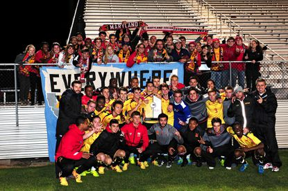 Maryland's men's soccer team celebrates after clinching the Big Ten regular season title with a win Wednesday at Rutgers.